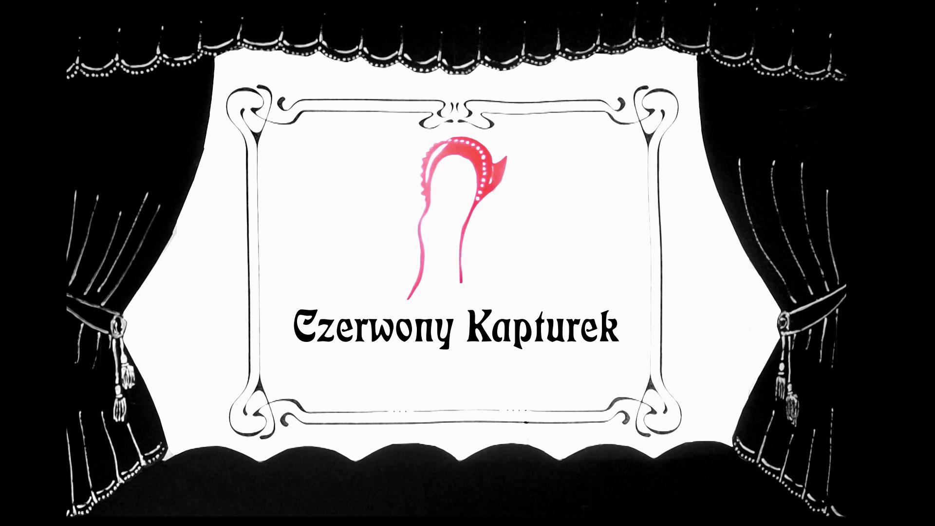 teatrzyk pudełkowo pomalowany na czarno z białymi akcentami, na środku w oknie sceny widoczny czerwony kapturek